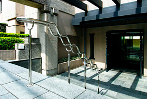 Entrance Hall (The entrance leads to a spacious lobby dappled with sunlight from a breezy inner courtyard.)